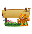 A playful bear near the empty wooden signboard vector