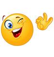 Winking emoticon vector