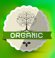 Organic label with tree sign on green blurred vector