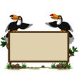 Couple toucan sitting on blank sign vector