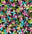 Seamless pattern of colored butterflies on black vector