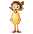A cute young girl wearing a yellow polka dress vector