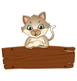 A cat with an empty wooden board vector