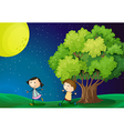 A girl and a boy playing under the bright fullmoon vector