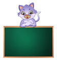 A cat leaning above the empty blackboard vector