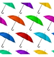Seamless colorful umbrellas background vector