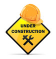 Under construction sign with helmet vector