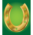 Lucky horseshoe on green background vector