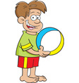 Cartoon boy holding a beach ball vector