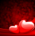 Two red shiny hearts on silk with light vector