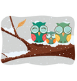 Owls family in a tree vector