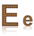 Letter e is made grains of coffee isolated on whit vector