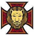 Lion head and iron cross in tattoo style vector