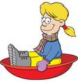 Cartoon girl on a snow sled vector
