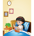 A young lady reading a storybook in her bed vector