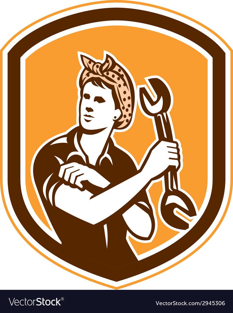 Female mechanic spanner shield retro vector | Price: 1 Credit (USD $1)