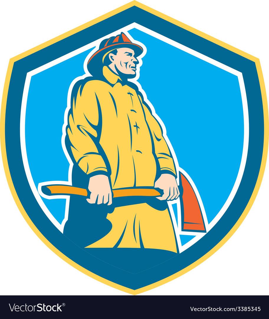 Fireman firefighter standing axe shield retro vector | Price: 1 Credit (USD $1)
