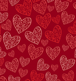 Seamless red pattern with hearts vector