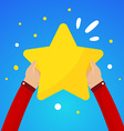 Two male hands holding a large yellow star on a vector