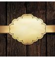 Golden label on wooden vector