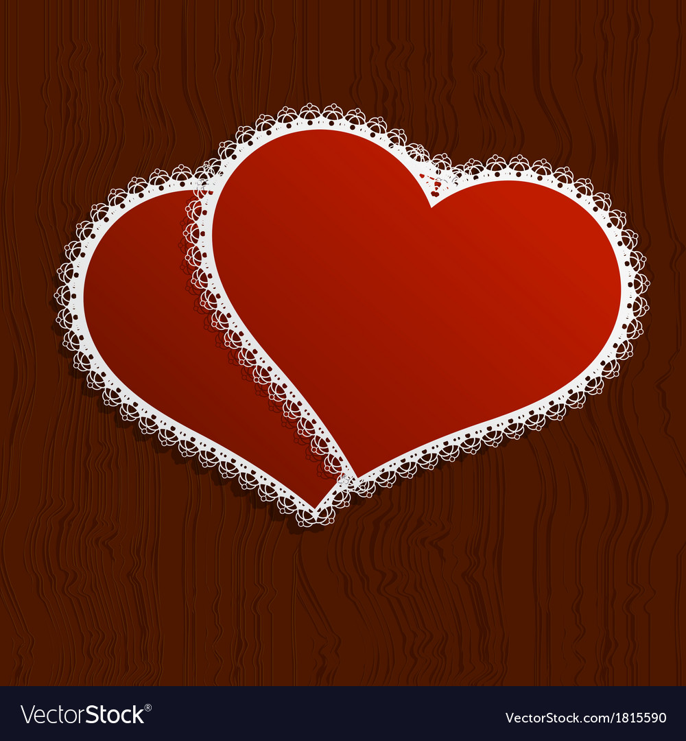 Two lacy red hearts on a wooden background vector | Price: 1 Credit (USD $1)