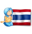 A muslim praying in front of the thailand flag vector