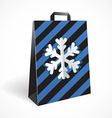 Festive black striped paper-bag with cut out vector