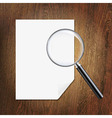 Wooden background with magnifying glass and paper vector