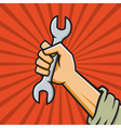 Raised fist holding wrench vector