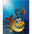 A scary fish under the sea near the rocks vector