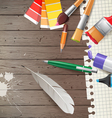 Wooden background with writing tools vector