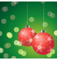 Red christmas balls on the green background vector