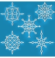 Set of ornate snowflakes against blue background vector