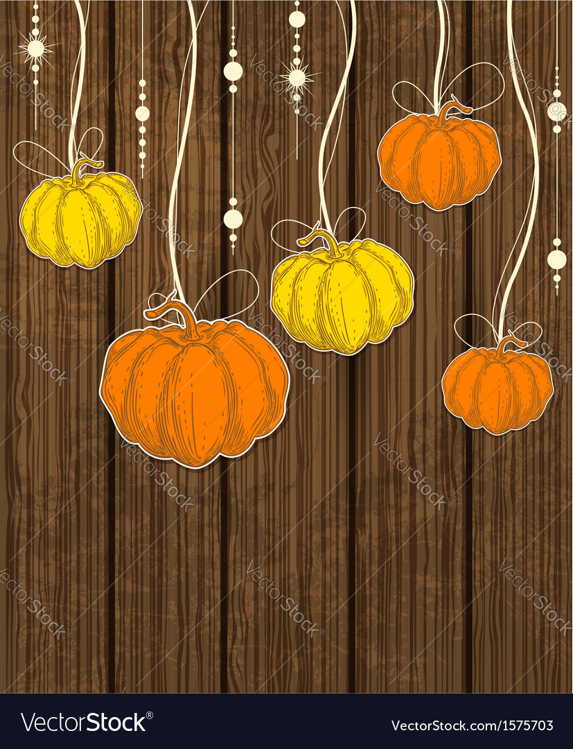 Pumpkins on wooden background vector | Price: 1 Credit (USD $1)