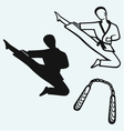 Karate male young fighter and nunchaku weapon vector