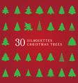 30 silhouettes of christmas trees vector