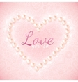 Light pink ornate background with pearly heart vector