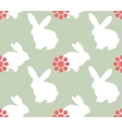 Cute seamless pattern with bunnies vector