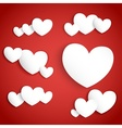White paper hearts on red background vector