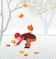 Little child collecting fallen leaves in a park vector
