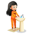 A young girl washing her hands vector