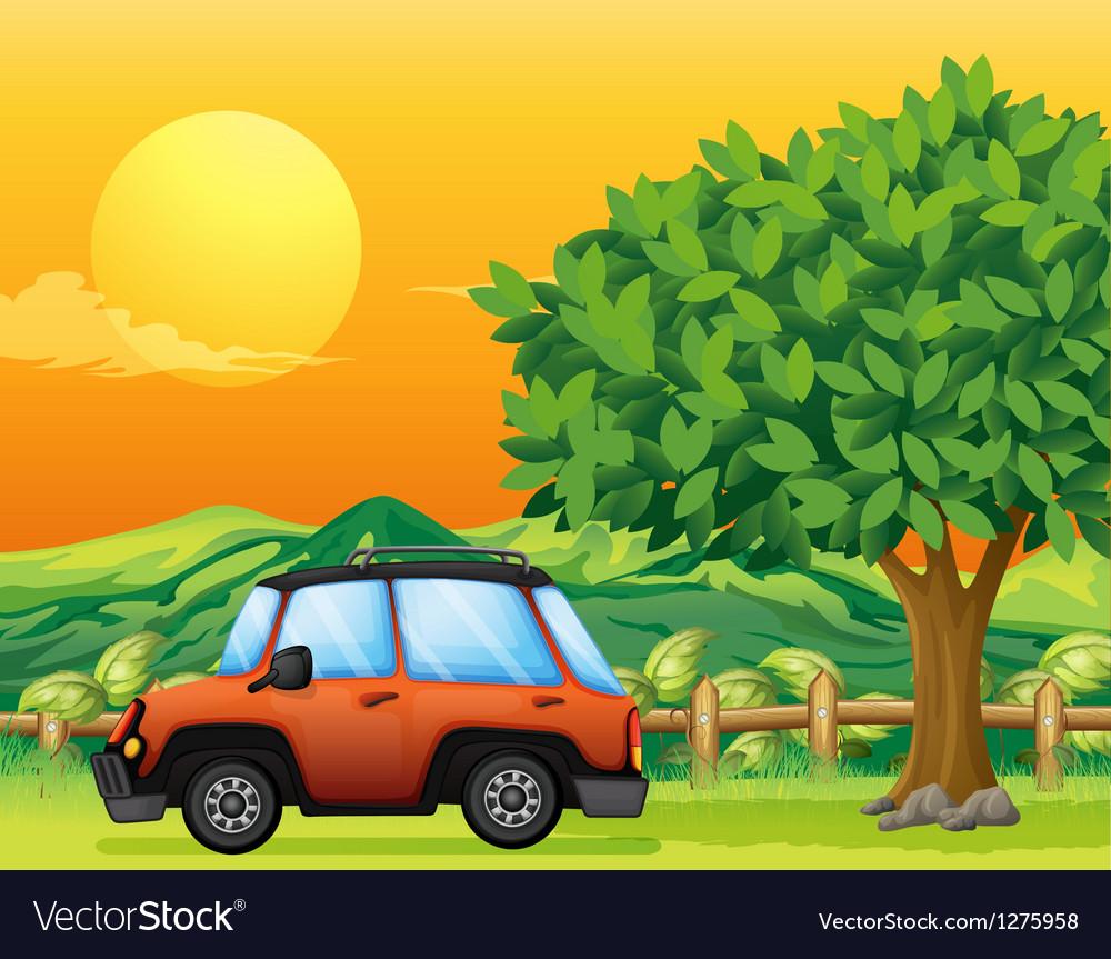 An orange vehicle near the big tree vector | Price: 1 Credit (USD $1)