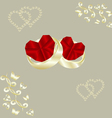 Wedding rings and ruby heart vector