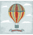 Grunge vintage hot air balloon in the sky with vector