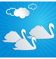 Blue background with white paper swans vector