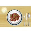 Pork stew on a wooden table vector