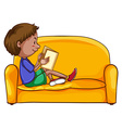 A boy reading while sitting down vector