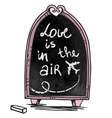 Love is in the air message on a chalkboard vector