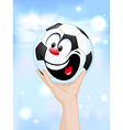 Happy winner - soccer ball in hand lifting the vector