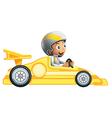 A boy riding in a yellow racing car vector